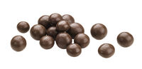 Cocoa balls, chocolate dragee isolated on white background