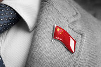 Metal badge with the flag of China on a suit lapel