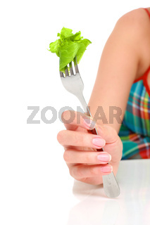 Healthy lifestyle concept. Hand with fork and salad isolated over white.