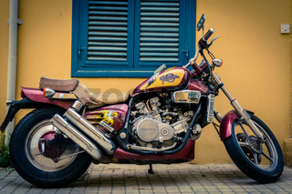 Honda Magna V45 motorcycle parked in front of a building
