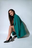 Stylish woman in blazer and high heels