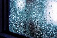 Rain drops on the window, rainy night with cool lights. Drop pattern, window frame