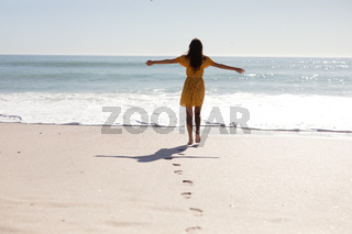 Caucasian woman standing on the beach