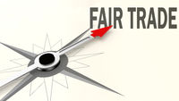 Fair trade word on compass with red arrow