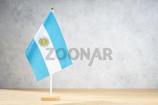 Argentina table flag on white textured wall. Copy space for text, designs or drawings