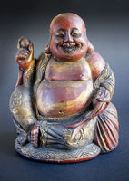 Tradional wooden statue of chinese Buddha