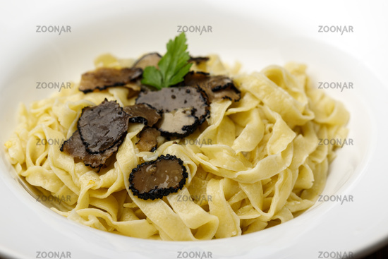 black truffle on homemade pasta