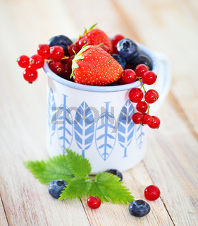 Delicious fresh fruits in the white and blue cup