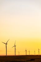 General view of wind turbines in countryside landscape during sunset