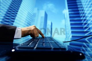 reseller work on keyboard skyscrapers on background