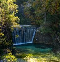 A view of the Pisnica Waterfall near Kranjska Gora in the Julian Alps of Slovenia in late autumn