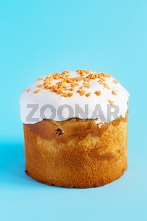Easter Cake - Russian and Ukrainian Traditional Kulich on a bright blue background. Paska Easter Bread. Happy easter. Kulich cake symbol of Traditional Orthodox Easter