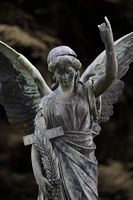 Cemetery female angel with cross and palm branch