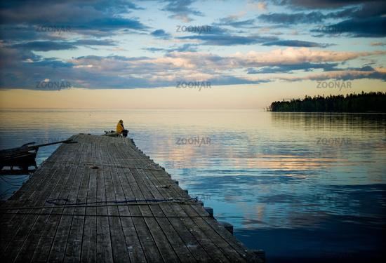 fisherman sitting in the pier