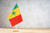 Senegal table flag on white textured wall. Copy space for text, designs or drawings
