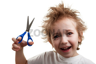 Child holding scissors
