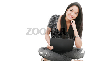 attractive young female sitting on the floor using laptop