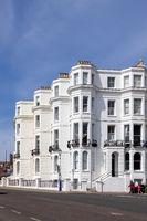 EASTBOURNE, EAST SUSSEX, UK - MAY 3 : View of some apartments in Eastbourne on May 3, 2021. Three unidentified people