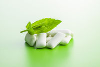 Mint chewing gum pads and mint leaves