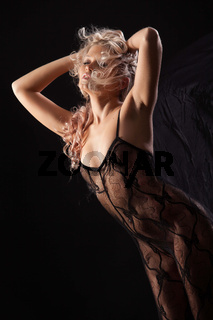 Young Woman In A Black Lingerie