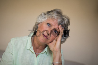 Close up of sad thoughtful senior woman at home