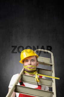 Portrait of a clumsy worker with measure tape