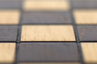 Macro photograph of empty chess board. White/brown squares.