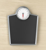 Weighing scale on wooden floor