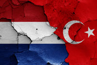 flags of Netherlands and Turkey painted on cracked wall