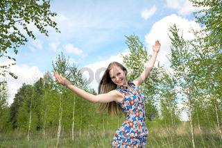 The girl with the lifted hands against   sky