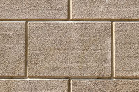 Background from a wall with rectangular beige stone slabs
