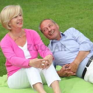 Happy laughing elderly couple