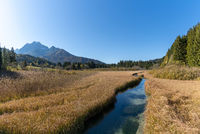 A landscape view of the Zelenci Nature Reserve in northern Slovenia with Triglav National Park in the background