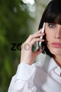 Woman holding mobile telephone