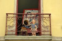 Doll and gramophone on a balcony
