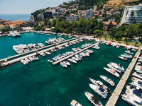 Boat dock and yacht port in Budva, Montenegro. Aerial photo from the drone.
