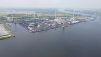 Amsterdam Westpoort, 11th of July 2021, The Netherlands. Coal storage facility aerial drone overview along the water.