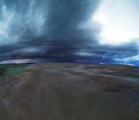 storm clouds over sand desert