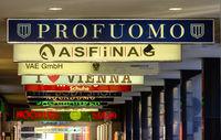 illuminated company nameplates at an arcade