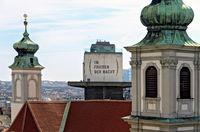 view across the Mariahilfer church and a former flak towe rin Vienna