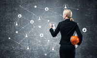 Businesswoman pointing on abstract 3d network
