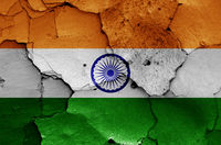 flag of India painted on cracked wall