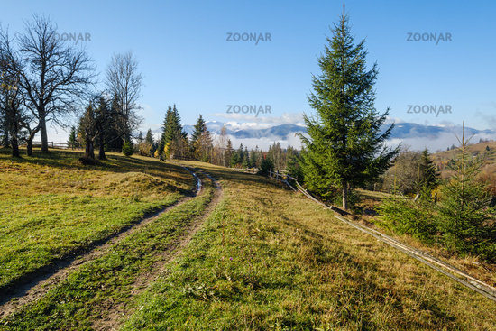Foggy autumn mountain morning scene. Peaceful picturesque traveling, seasonal, nature and countryside beauty concept scene.