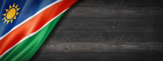 Namibian flag on black wood wall banner