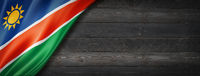 Namibian flag on black wood wall banner