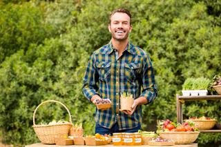 Portrait of handsome man selling organic vegetables