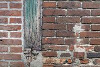 Background photo of an old historic wall with restoration work and wooden beams
