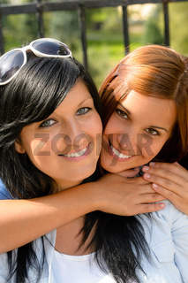 Daughter hugging her mother outdoors happy loving