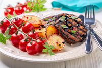 Delicious grilled eggplant steaks with vegetables.