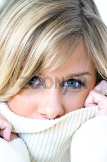 Young blond woman in roll-neck sweater